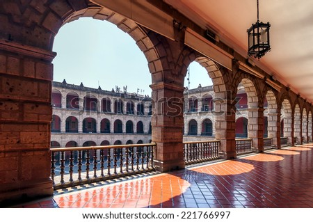 National Palace in Mexico City, Mexico. The building is located on Mexico City's main square, the Plaza de la Constitucion (El Zocalo). - stock photo
