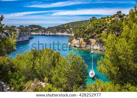 National Park Calanques on the Mediterranean coast. White sailing yacht sailing on the lagoon - stock photo