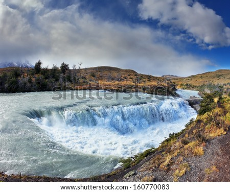 National Park Torres del Paine in Chile.  The raging waterfall on the Rio Paine. - stock photo