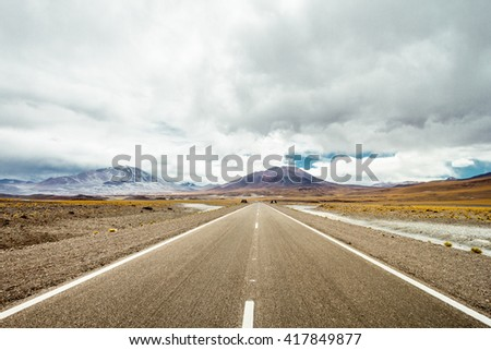 National Route 60 between the mountains of the Andes, in the highlands of Argentina. Background, volcanoes San Francisco and Ojos del Salado - stock photo
