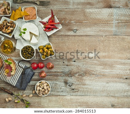 National Spanish tapas on a wooden background - stock photo