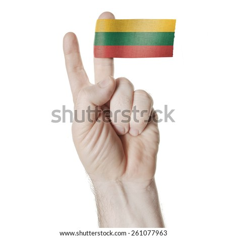 National symbol of victory: a hand with two fingers with the flag of Lithuania - stock photo