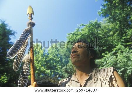 Native American Cherokee holding a spear, Tsalagi Village, Cherokee Nation, OK - stock photo