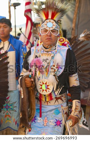 Native American in full regalia dancing at Pow wow - stock photo