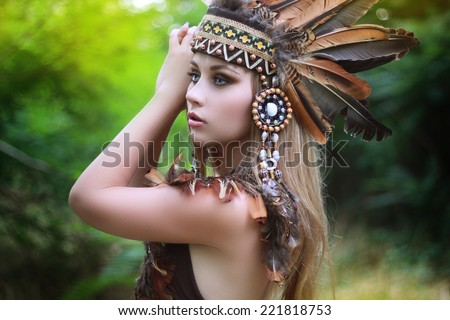 Native american, Indians in traditional dress, in the wild forest - stock photo