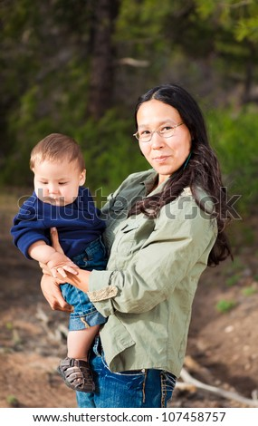 Native American mother with her mixed race son - stock photo