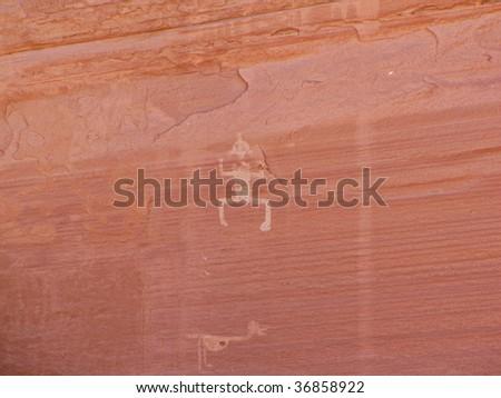 Native American petroglyph on canyon wall - stock photo