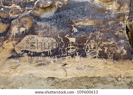 Native American Rock Art Petroglyphs � Big Buffalo Site at Nine Mile Canyon, UT - stock photo