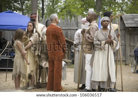 Native Americans and African slave reenactors posing as part of the 400th anniversary of the Jamestown Colony, Virginia, at the James Fort, Jamestown Settlement, May 4, 2007 - stock photo
