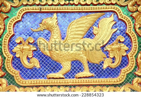 Native art carved on the wall in the temple. - stock photo