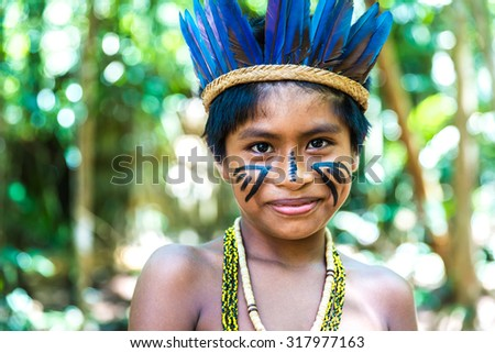 Native Brazilian boy at an indigenous tribe in the Amazon - stock photo
