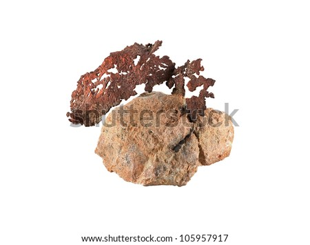 Native copper ore from the Upper Peninsula of Michigan extruding from a rock matrix - stock photo