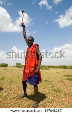 Native Masai warrior posing in Masai Mara National Park, Kenya - stock photo