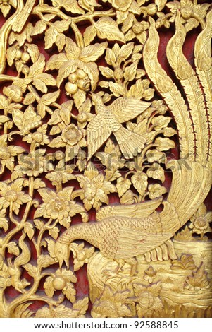 Native Thai style wood carving in the temple - stock photo