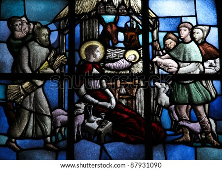 Nativity Scene, stained glass window depicting the adoration of the child Christ by the shepherds in Bethlehem. - stock photo