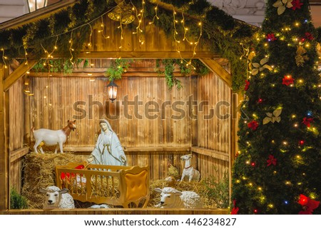 Nativity scene with Holy family of Joseph, Mary, baby Jesus Christ and sheep, holiday decorations in the Old Town in the magical city of Prague at night, Czech Republic - stock photo