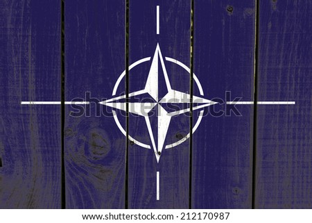 Nato flag on wooden background  - stock photo