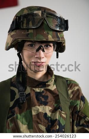 NATO soldier. Military woman over khaki background. - stock photo