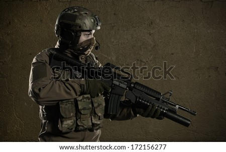 NATO soldiers patrol the area. Protect military object. - stock photo