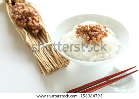 Natto on rice with chopsticks - stock photo
