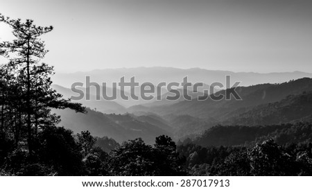 Natural aerial view of mountain during sunrise in northern of Thailand. Black and white image. - stock photo