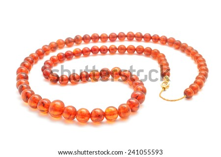 natural amber necklace on white - stock photo