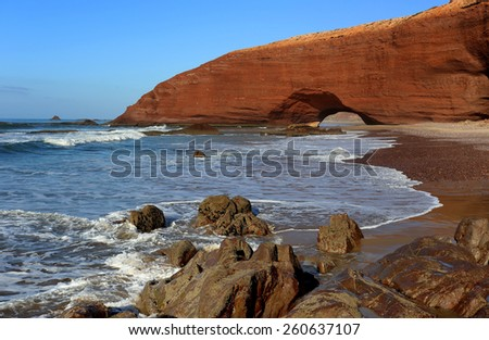 Natural arch on Legzira Beach in Morocco - stock photo