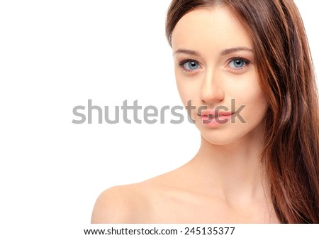 Natural as she is. Portrait of beautiful young caucasian shirtless woman looking at camera while standing against white background - stock photo