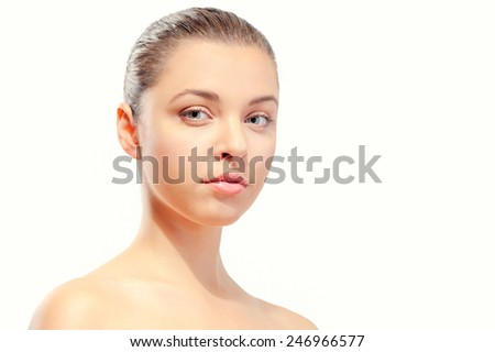 Natural as she is. Portrait of beautiful young caucasian shirtless woman looking at camera while standing isolated against white background - stock photo