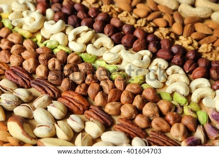 Natural background made from different kinds of nuts. - stock photo