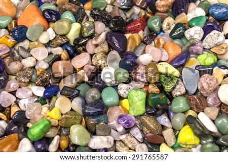 natural background - pile of semiprecious gems closeup - stock photo