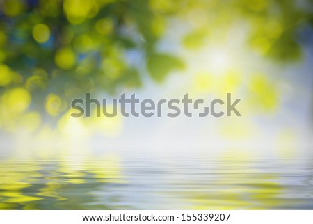 Natural background with rays of light, reflected in water - stock photo
