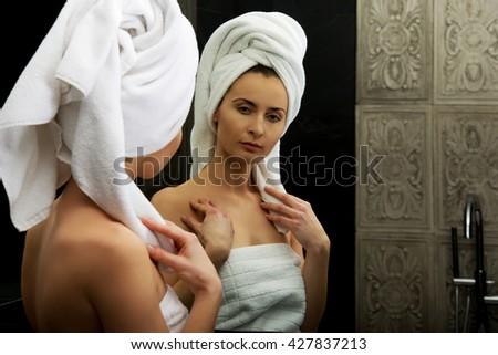 Natural beautiful woman in bathroom. - stock photo