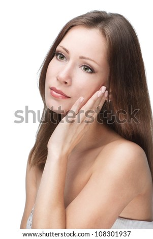 Natural beauty. Beautiful young woman touching her face isolated on white background - stock photo