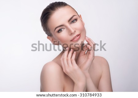 Natural beauty portrait of beautiful young woman model face with clean skin. Wellness, skincare and naturally make-up - stock photo