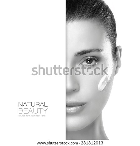 Natural Beauty. Skin care concept with a half face portrait of a gorgeous woman with a healthy clean skin and cosmetic cream on her cheek. Spa treatment. Template design with sample text - stock photo