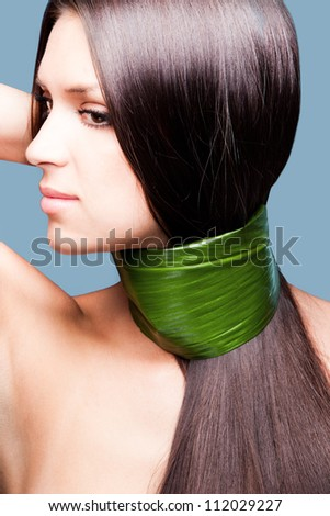 natural beauty woman portrait with leaf around hair and nack profile studio shot vertical - stock photo