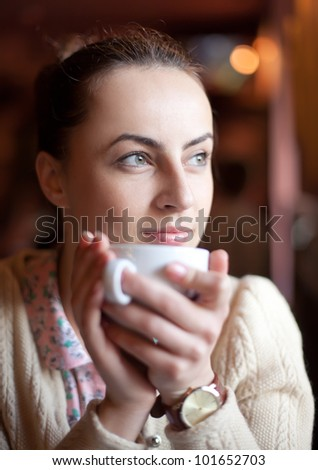 Natural beauty woman relaxing in cafe enjoying coffee and dreaming - stock photo