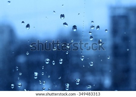 Natural blue texture of water drops on turbid window glass - stock photo