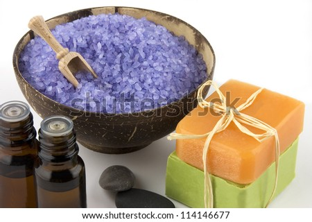 Natural body care set: bars of sandal and olive soap, aroma oil and lavender sea salt on white - stock photo