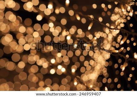 Natural bokeh. Photo of holidays lights blurred, small DOF - stock photo