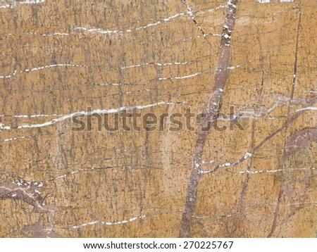natural brown marble with different shades, beautiful stains and stripes in a large slab - stock photo