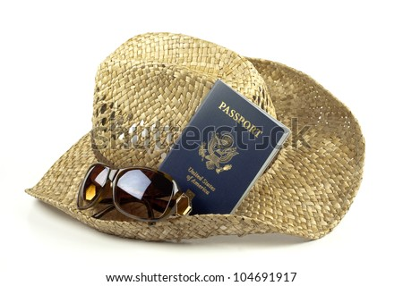 Natural brown straw sun hat with sunglasses and American passport isolated on white background with copy space. - stock photo