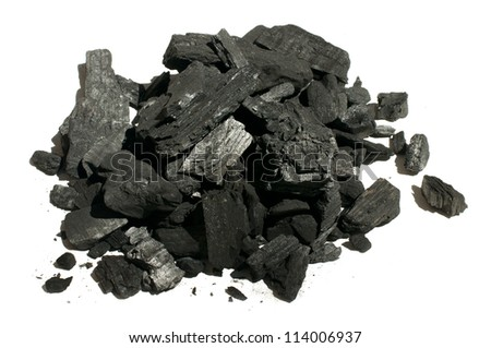 Natural charcoal close up. White isolated - stock photo