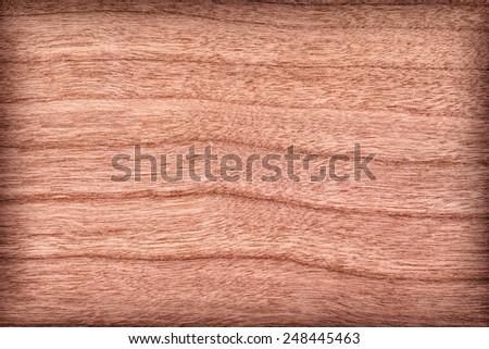 Natural Cherry Wood Brownish Red Veneer, vignette, grunge texture sample. - stock photo