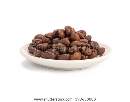 Natural coffee beans heap in bowl, isolated on white. Shallow DOF  - stock photo