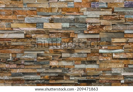 Natural colorful stone wall for background and texture - stock photo