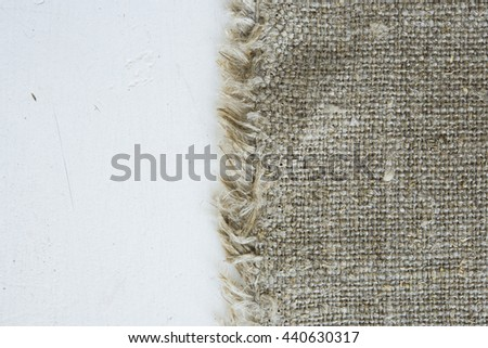 Natural cotton fabric texture . linen fabric white wooden board . white paint wooden board . linen cloth bag white wooden background - stock photo