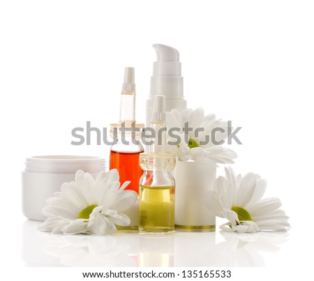 natural facial cosmetics products and chamomiles isolated on white - stock photo