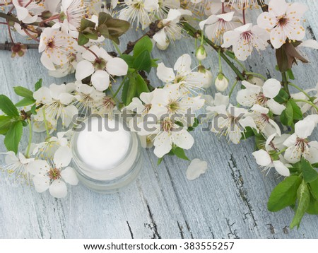 natural facial cream with spring blossom, Fresh as Spring Flowers - stock photo